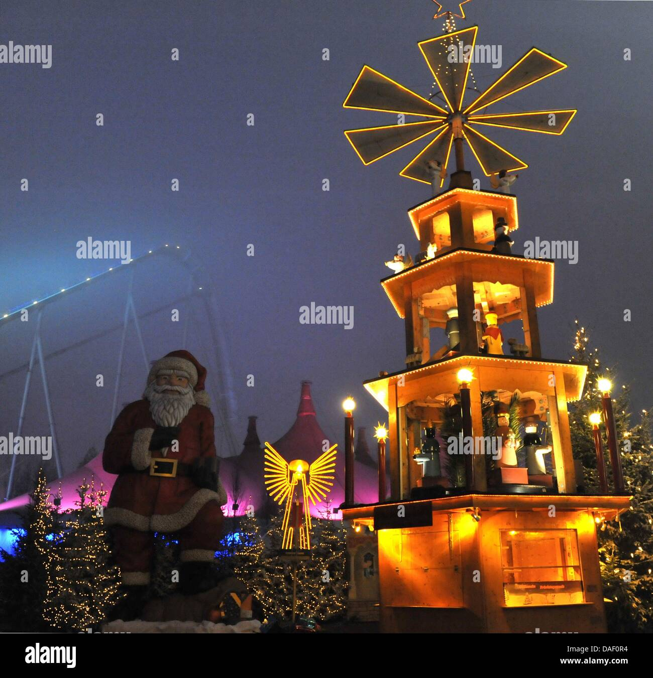 An oversized Christmas pyramid sheds its light at the Europa Park in Rust,Germany, 23 November 2011. From - Stock Image