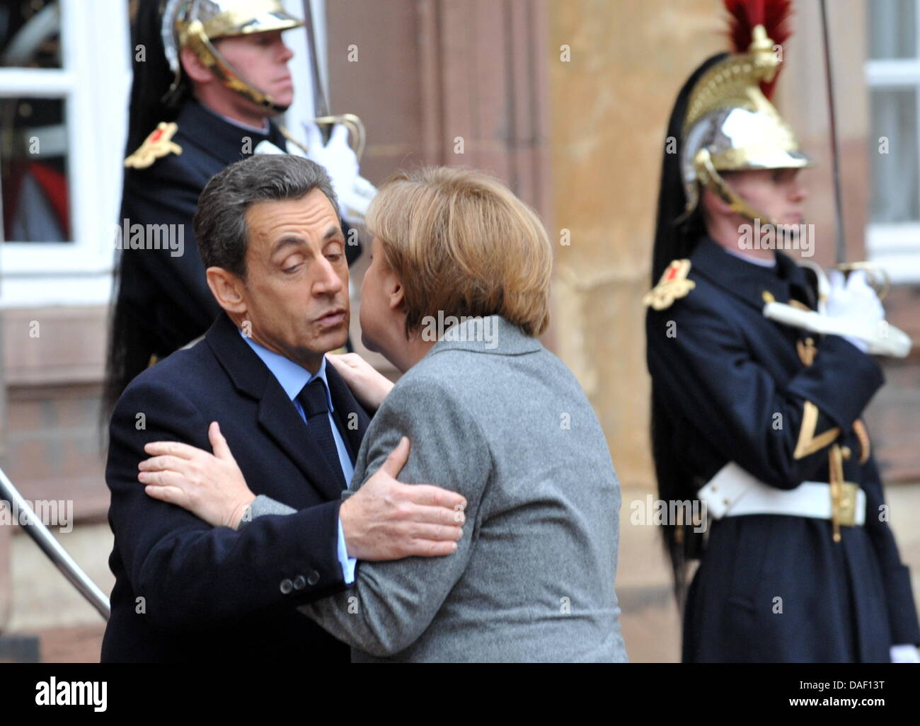 French President Nicolas Sarkozy L Greets German Chancellor Angela