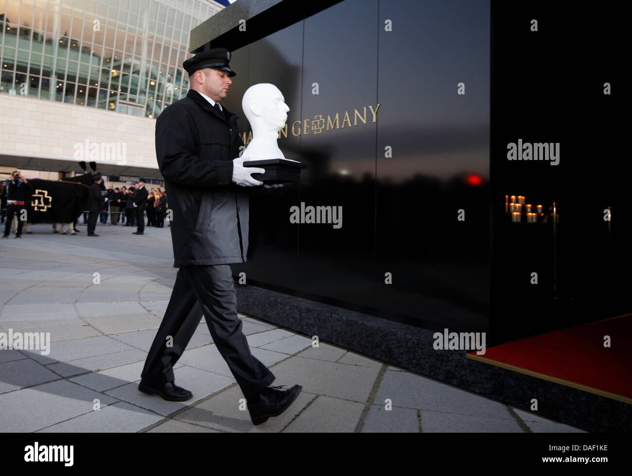 An Undertaker Carries The Symbolic Death Mask Into The Mausoleum In
