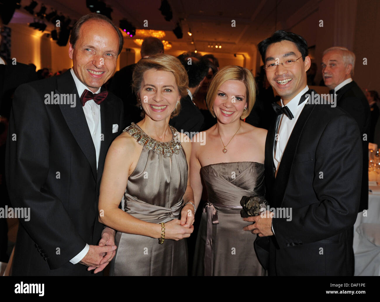 German Labour Minister Ursula von der Leyen (2nd L, CDU) and her husband Heiko (L), German Minister of Economy Philipp Roesler (R) and his wife Wiebke, attend the 60th annual press ball 'Bundespresseball' at the Hotel Intercontinental in Berlin, Germany, 25 November 2011. Photo: Jens Kalaene