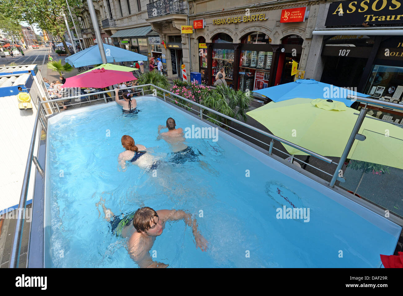 Karlsruhe germany 11th july 2013 people go for a swim in a mobile stock photo 58108787 alamy - Seecontainer pool ...
