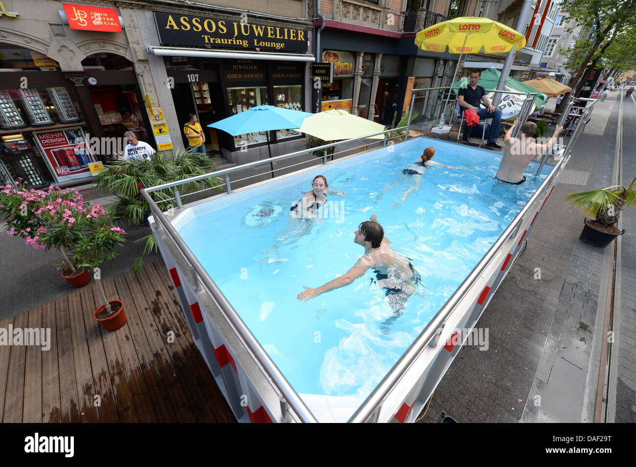 Mobile Pool karlsruhe, germany. 11th july, 2013. people go for a swim in a