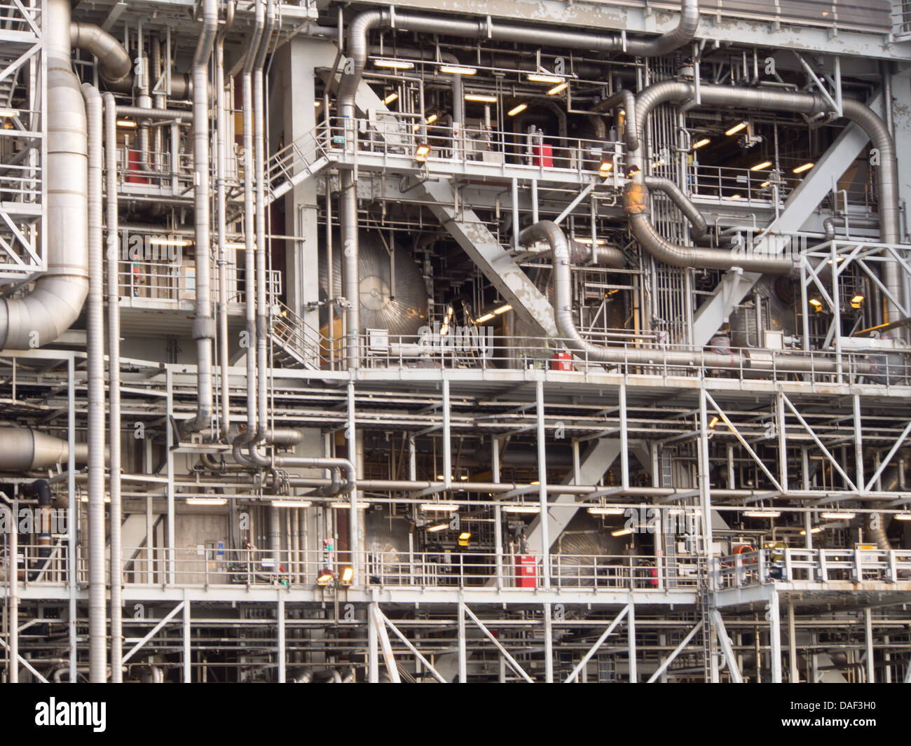 Piping and steel constructions on an offshore platform in the North Sea - Stock Image