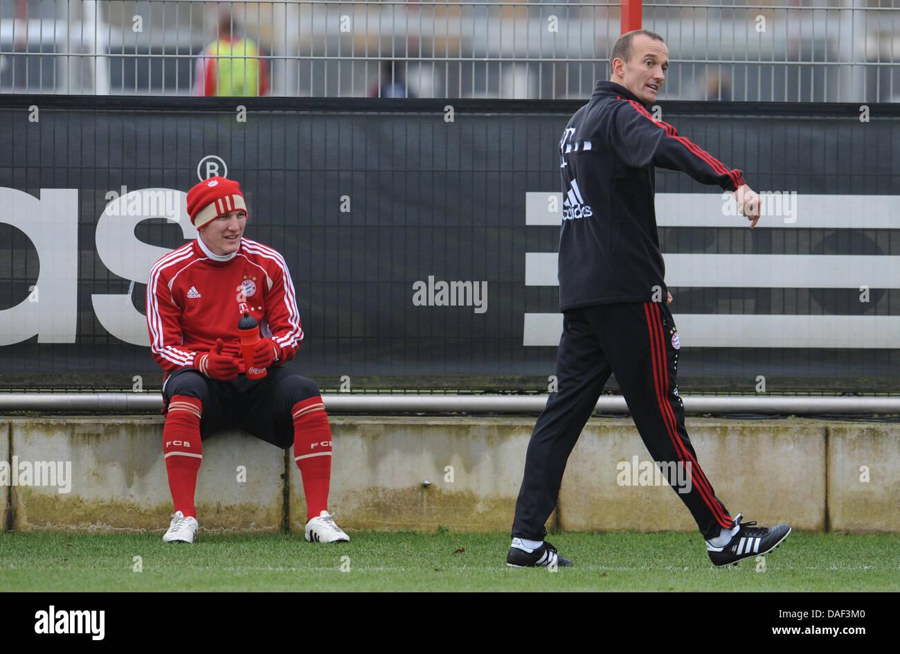 Professional soccer player Bastian Schweinsteiger (L) of FC