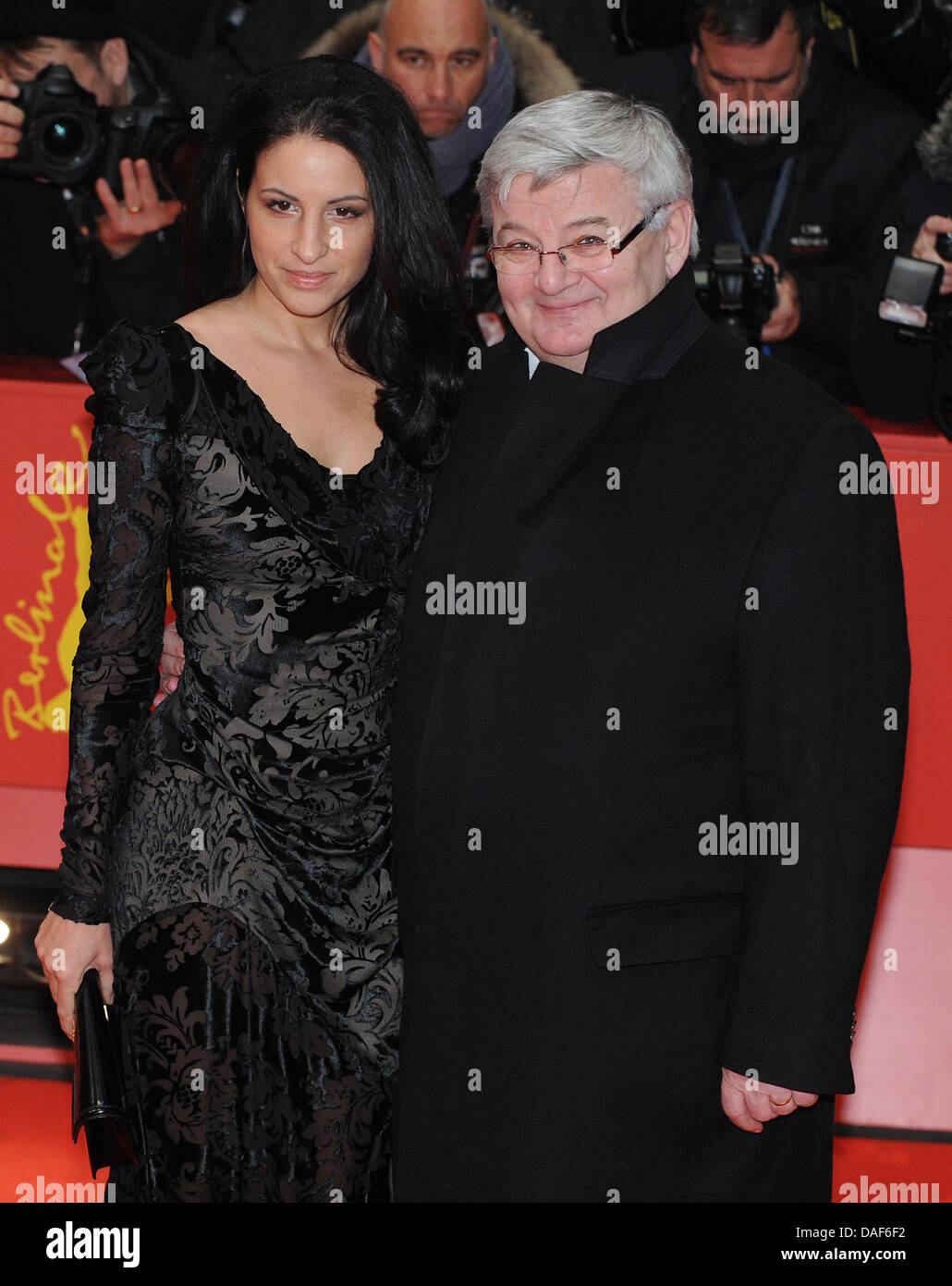 Former German foreign minister Joschka Fischer and his wife Minu Barati-Fischer arrive for the premiere of the film'True - Stock Image