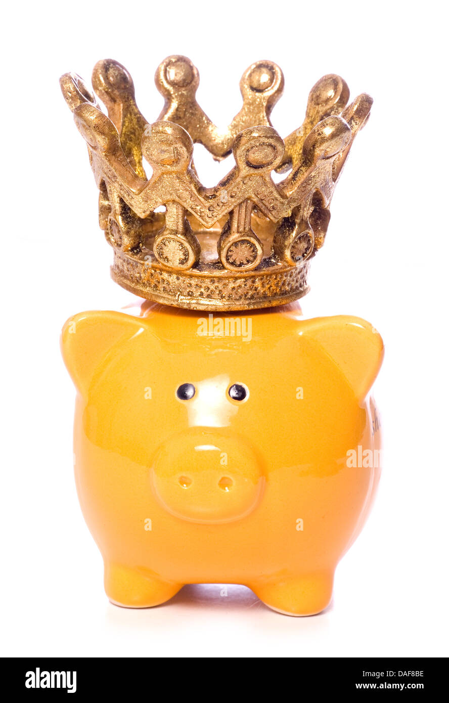 Piggybank with crown studio cutout - Stock Image