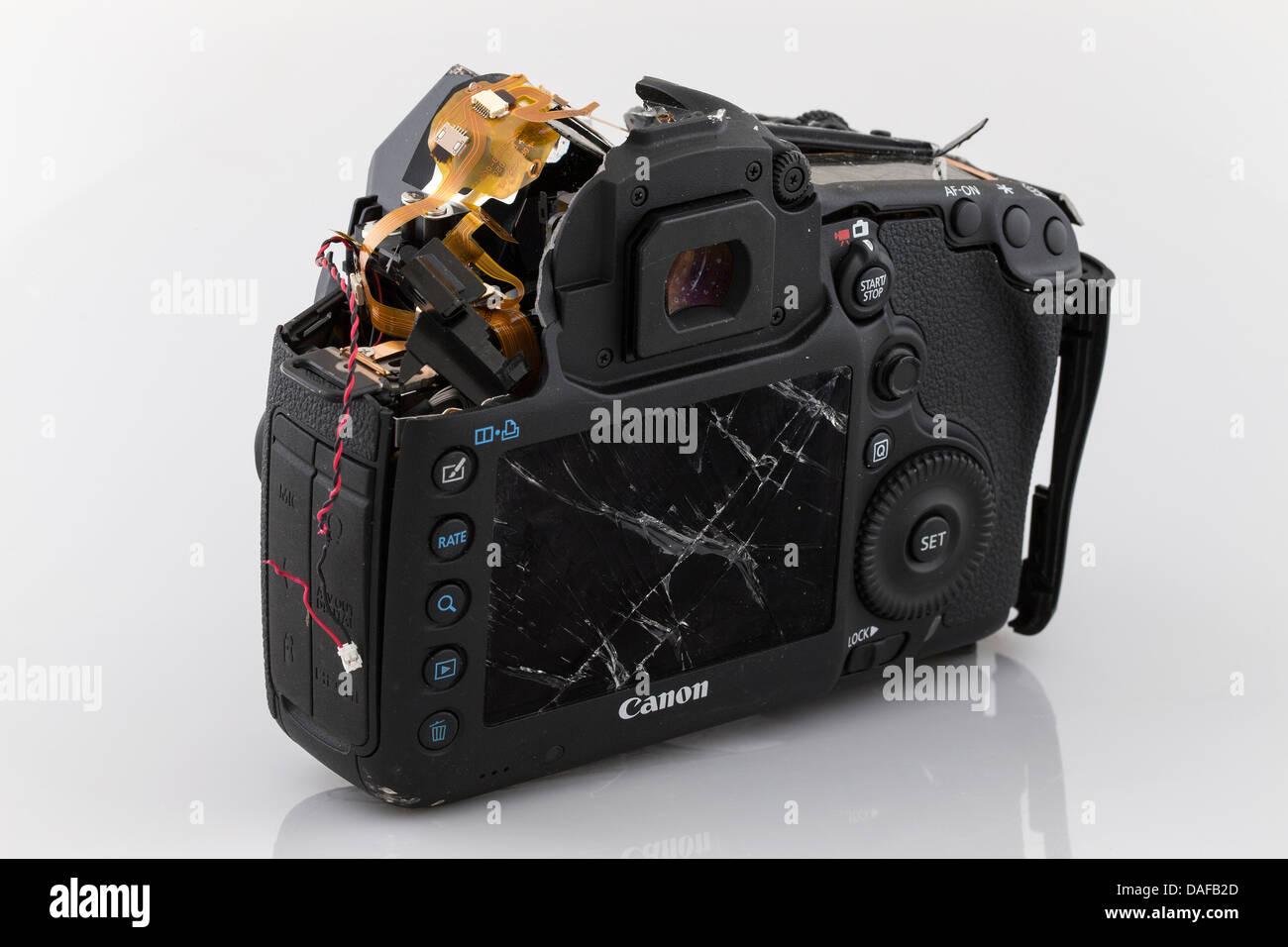 Broken camera canon 5d mkiii smashed camera pieces of a for Camera camera camera