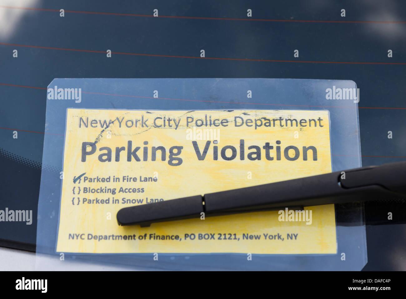 Imitation Parking Violation ticket stuck on car window Derbyshire England - Stock Image