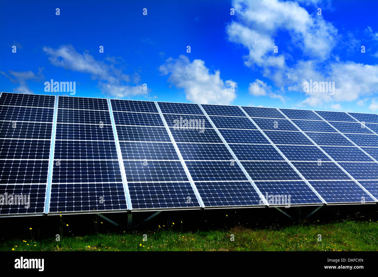 Solar farm with large solar panels in an array, France, Europe - Stock Image