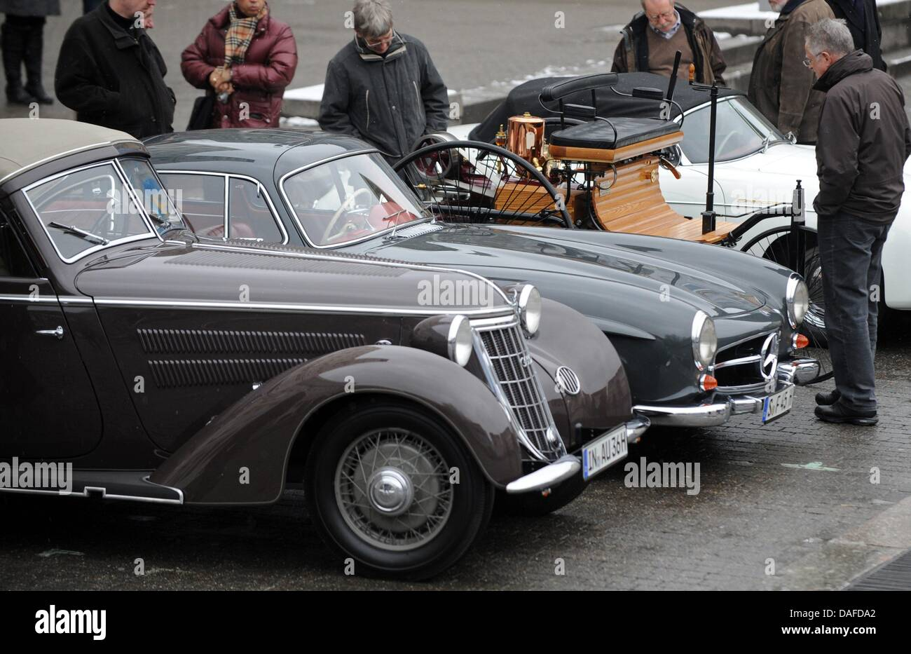(L to R) An Audi Wanderer W25K coupe a Mercedes 300SL with gull-winged doors a replica 1886 Benz Patent motorcar and a Porsche 356 Speedster are parked ... & L to R:) An Audi Wanderer W25K coupe a Mercedes 300SL with Stock ...