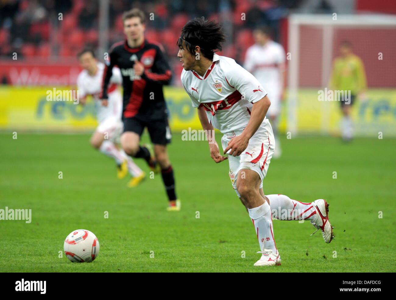 Stuttgart's Shinji Okazaki runs with the ball during the Bundesliga soccer match between Bayer Leverkusen and - Stock Image