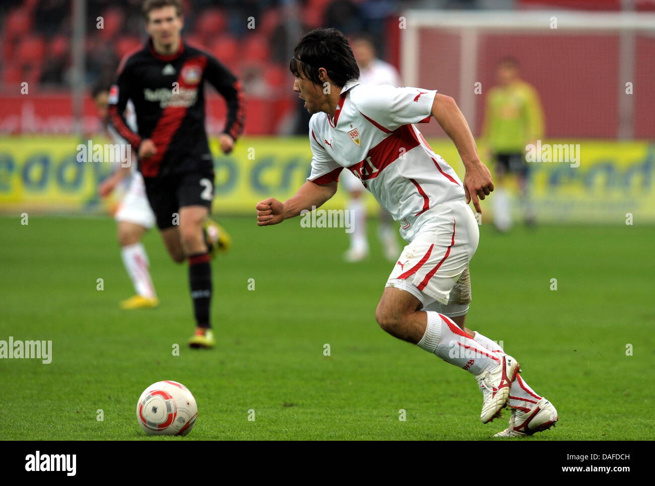 Stuttgart's Shinji Okazaki runs with the ball during the Bundesliga soccer match between Bayer Leverkusen and VfB Stock Photo