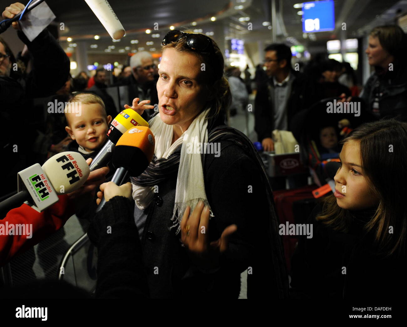 Katja T. from Berlin accompanied by her children speaks to journalists on her arrival from Tripoli, Libya, at the - Stock Image