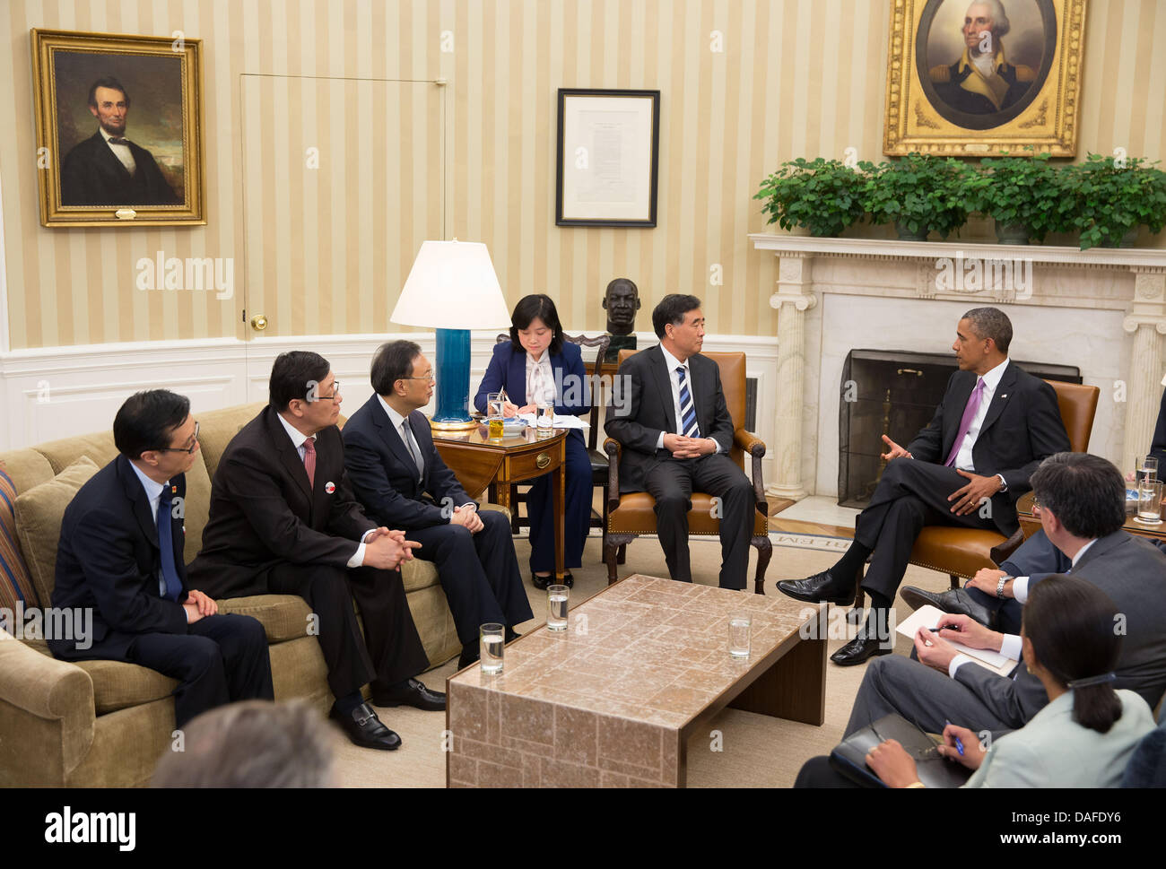 US President Barack Obama meets with Chinese Vice Premier Wang Yang and State Councilor Yang Jiechi in the Oval - Stock Image