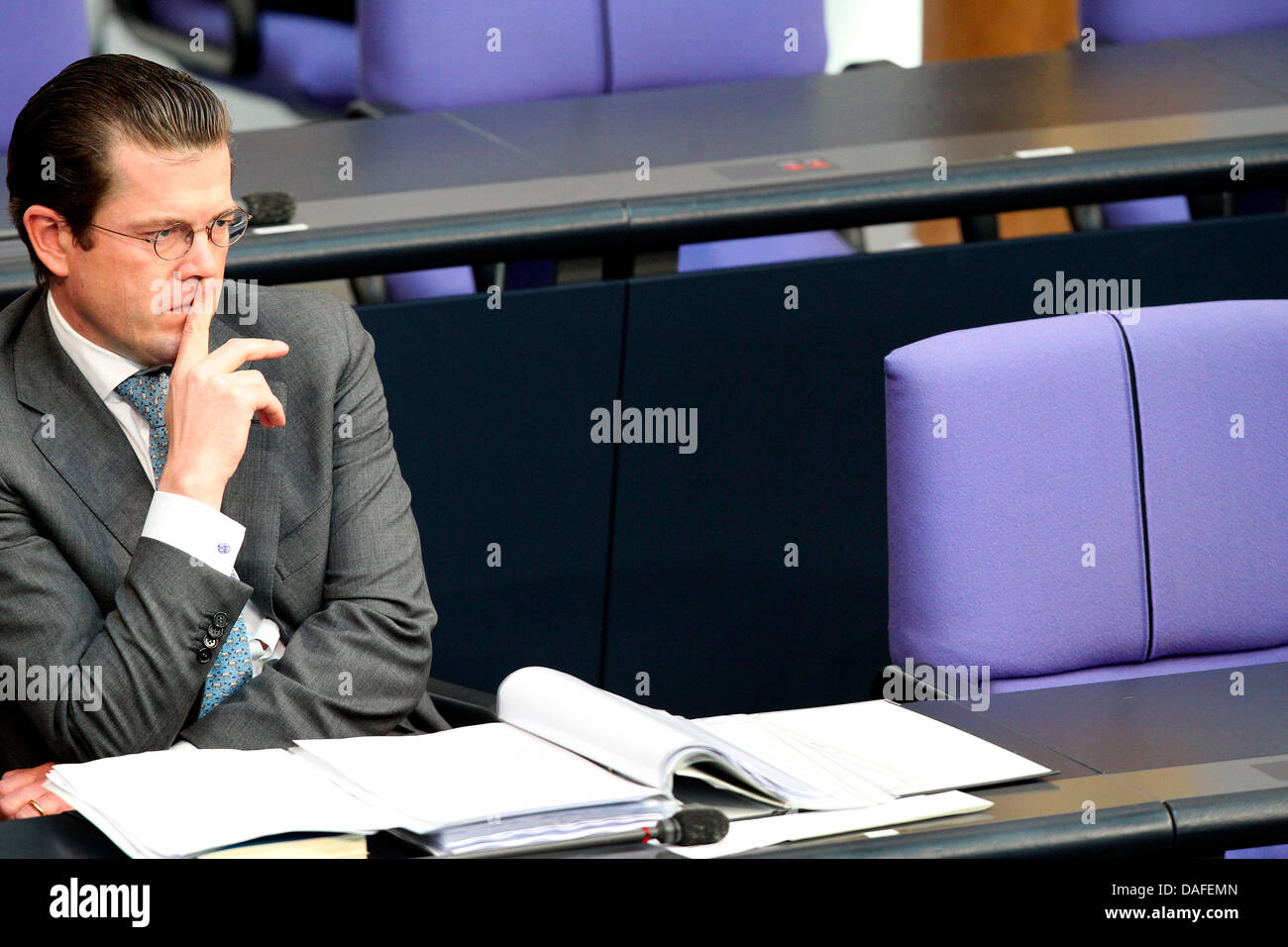 German Minister of Defence Karl-Theodor zu Guttenberg sits the German Bundestag during a question time in Berlin, - Stock Image