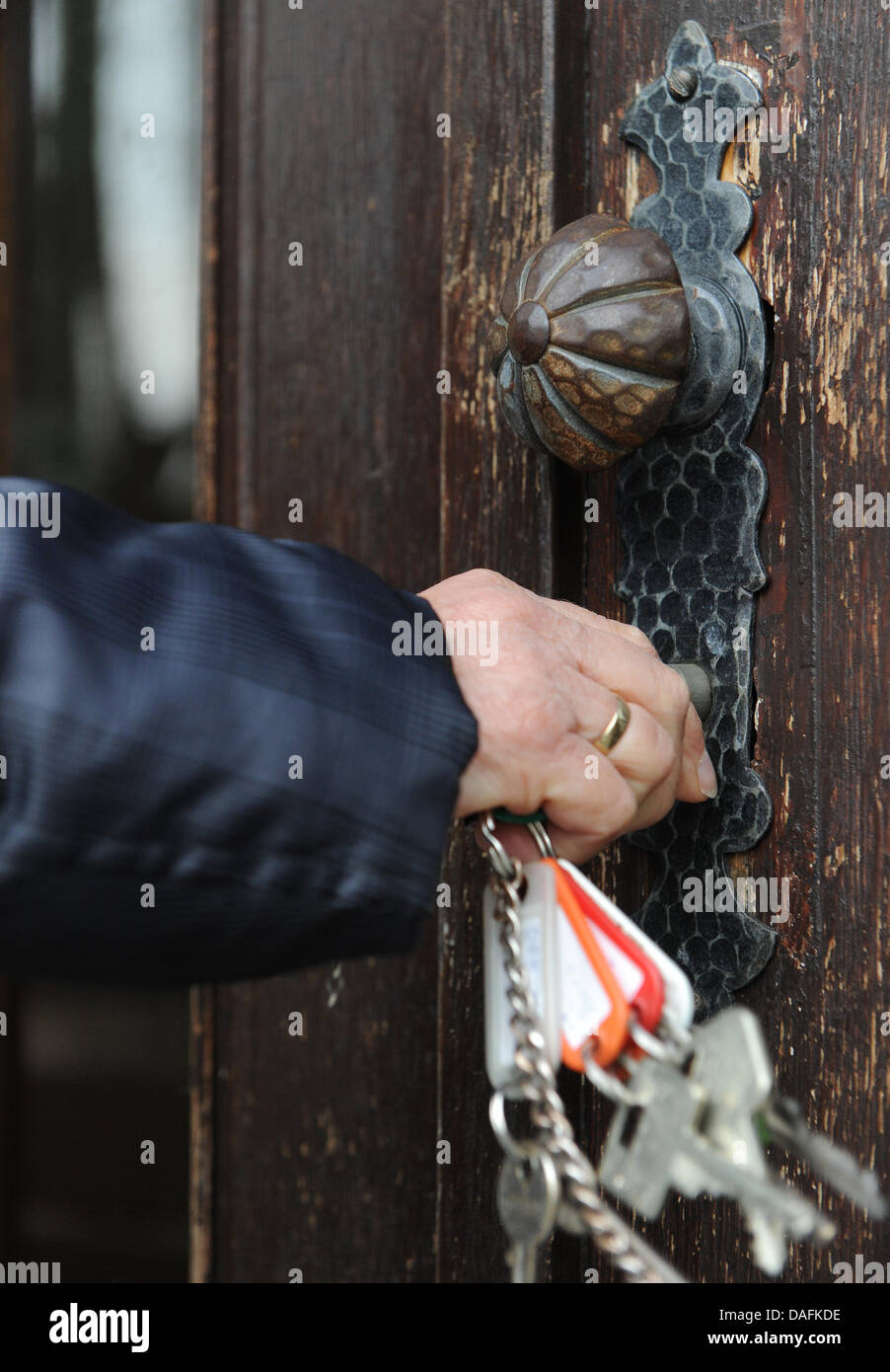 A woman closes the door of the now officially closed Emmerthal public school in Hanover, Germany, 16 February 2011. - Stock Image