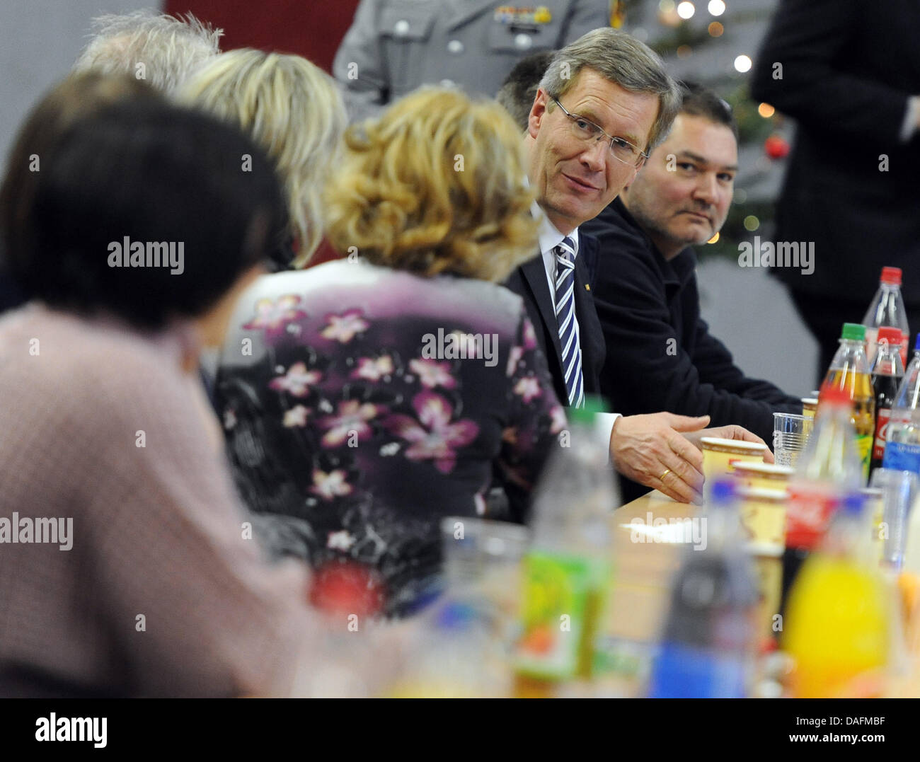 German President Christian Wulff (2-R) talks to soldiers' relatives at the Julius-Leber Barracks in Berlin, Germany, - Stock Image