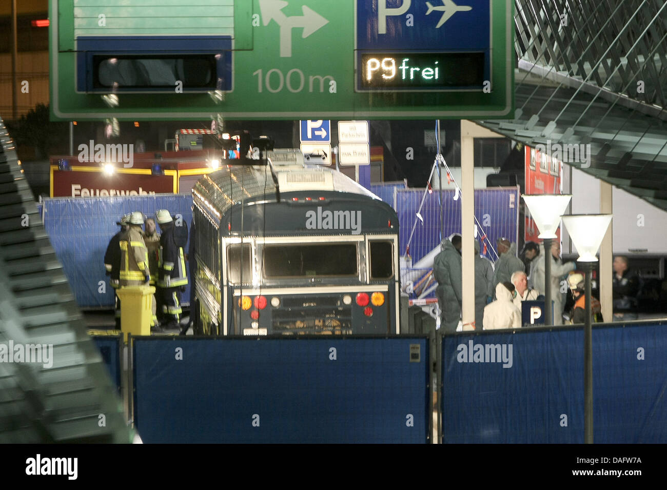Experts of the police crime scene unit examine a US military bus following a deadly attack at the airport in Frankfurt, - Stock Image