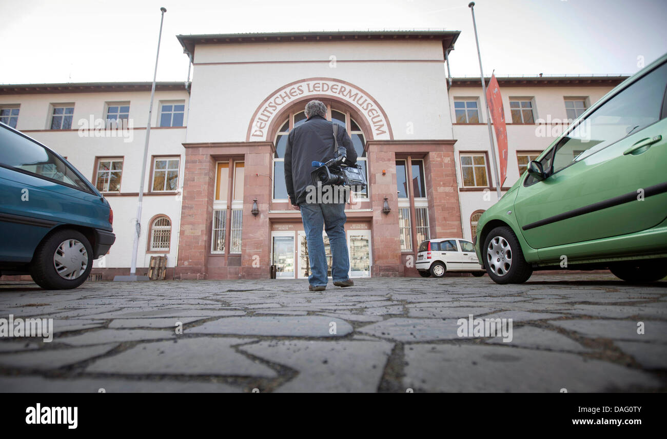 A camera man enters the German Leather Museum in Offenbach for a press tour in Offenbach, Germany, 9 March 2011. - Stock Image