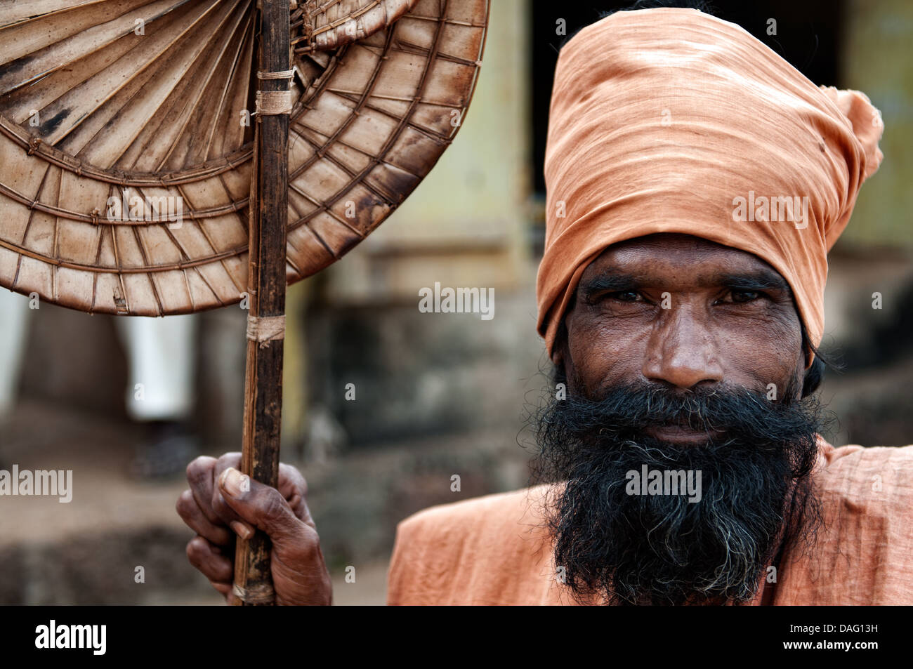 Portrait of sadhu in orange clothes. Bhubaneswar, Orissa, India - Stock Image