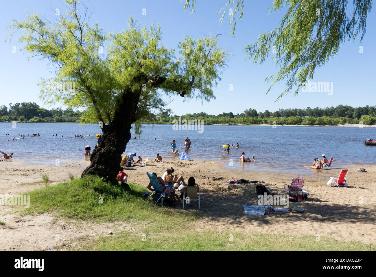 Public beach on the bank of the Rio Negro in the town of Mercedes, Soriano department, Uruguay - Stock Image