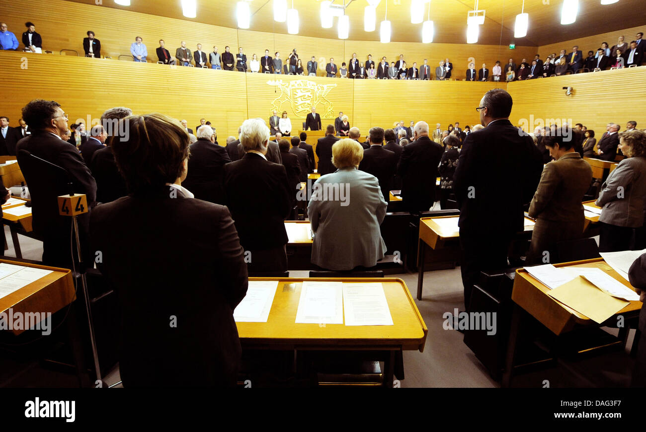 The members of the state parliament of Baden-Wuerttemberg stand during a minute of silence for the victims of the - Stock Image