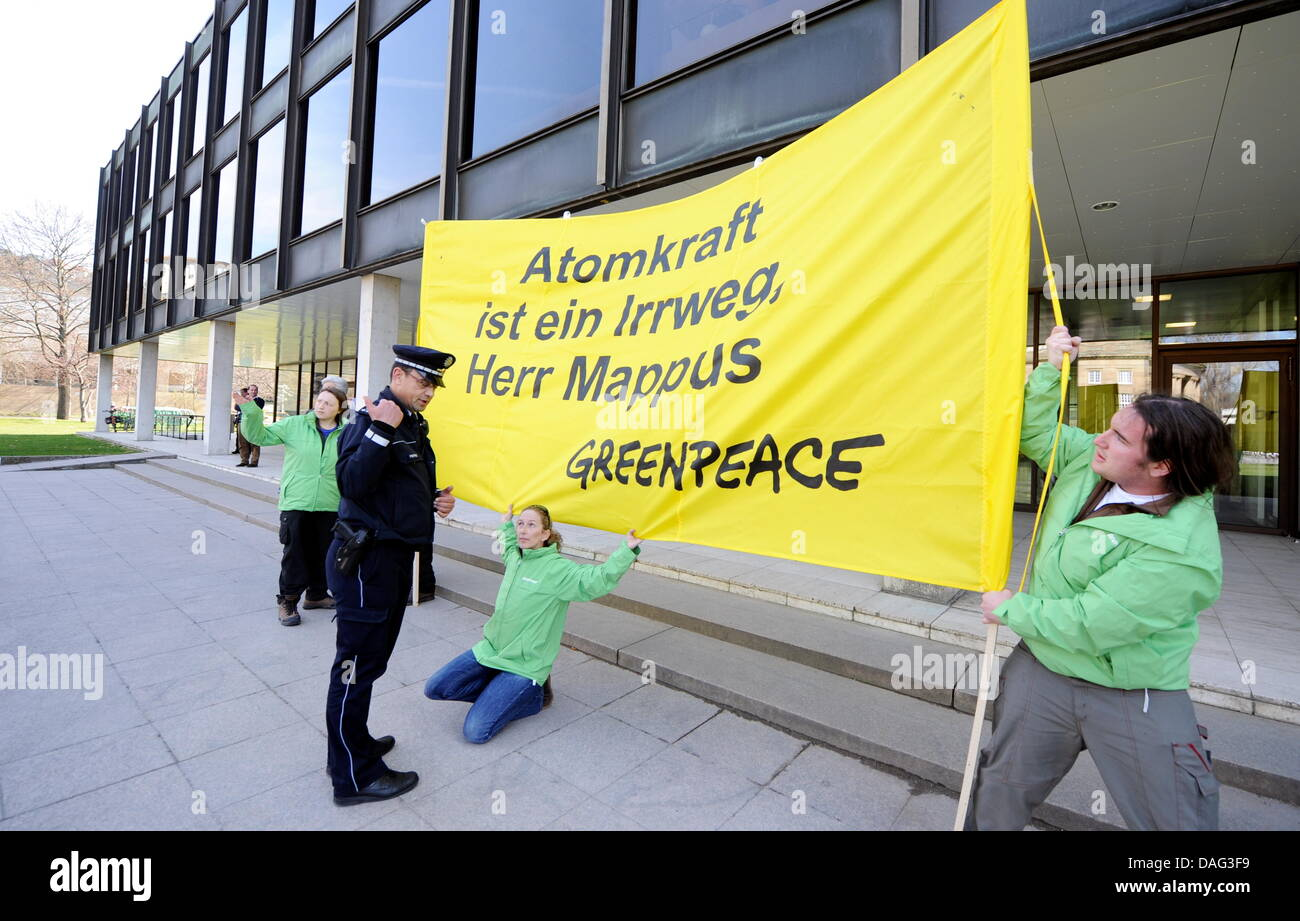 Greenpeace activists hold a banner with the caption 'Nuclear energy is not the way, Mr Mappus' in front - Stock Image