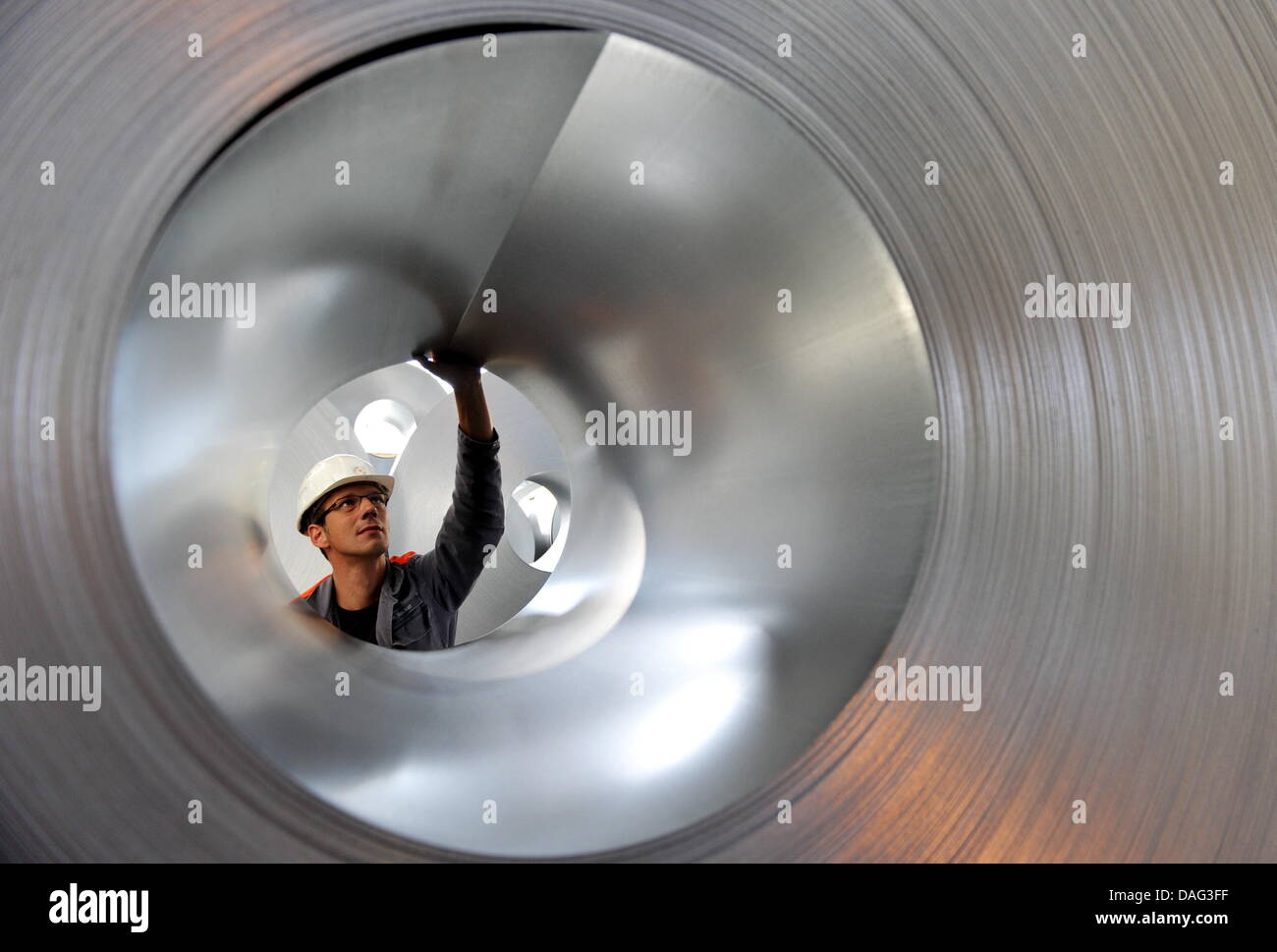 A file picture taken on 15 September 2010 shows a worker at a steel plant in Salzgitter, Germany, 15 September 2011. - Stock Image