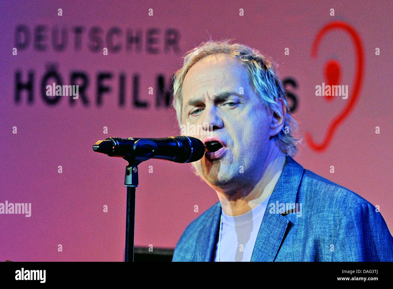 German actor Uwe Ochsenknecht speaks during a prize ceremony for audio description, organised by the German Council - Stock Image