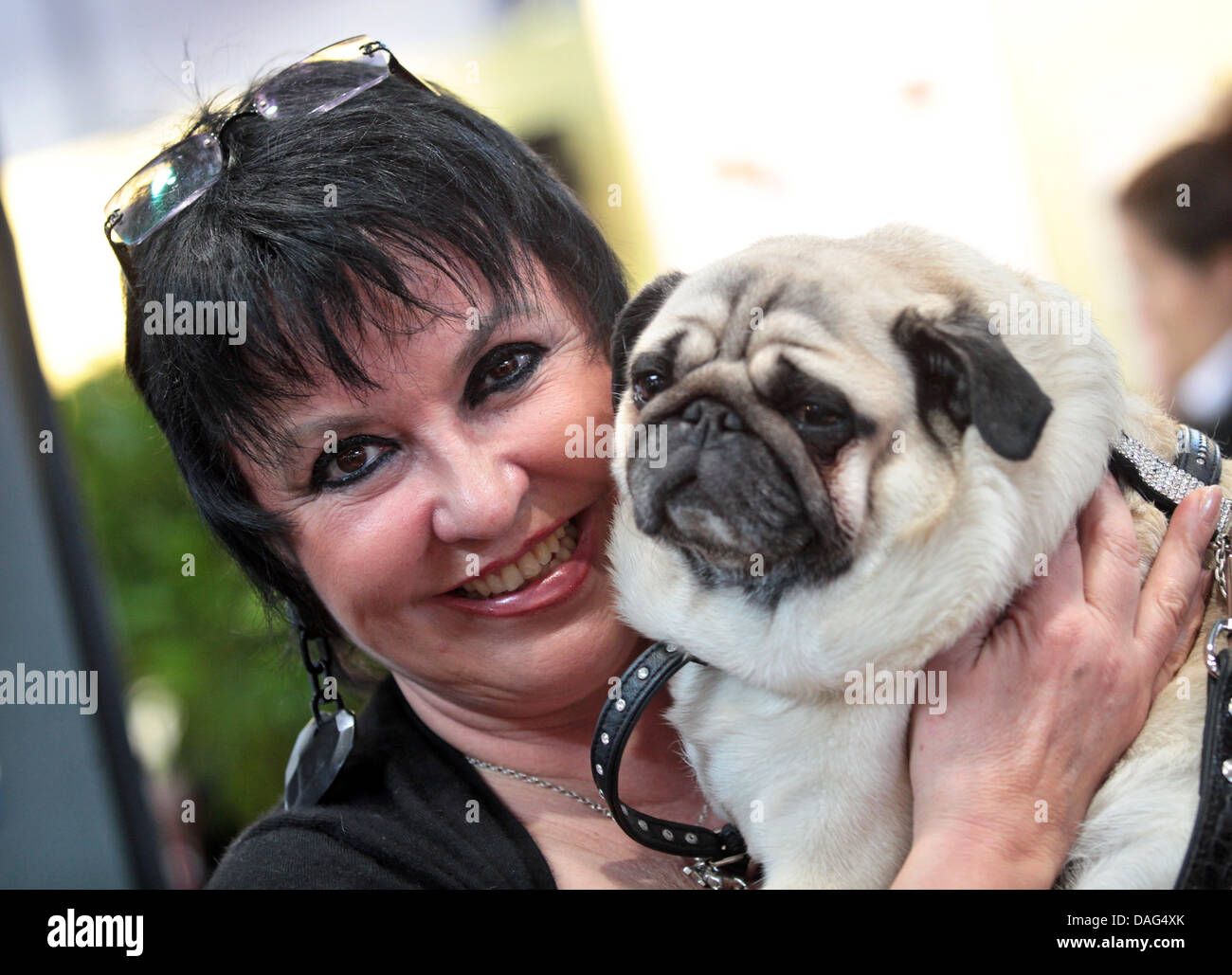 Publicist Uschi Ackermann and her pug 'Sir Henry' pose for a picture during the presentation of Ackermann's - Stock Image