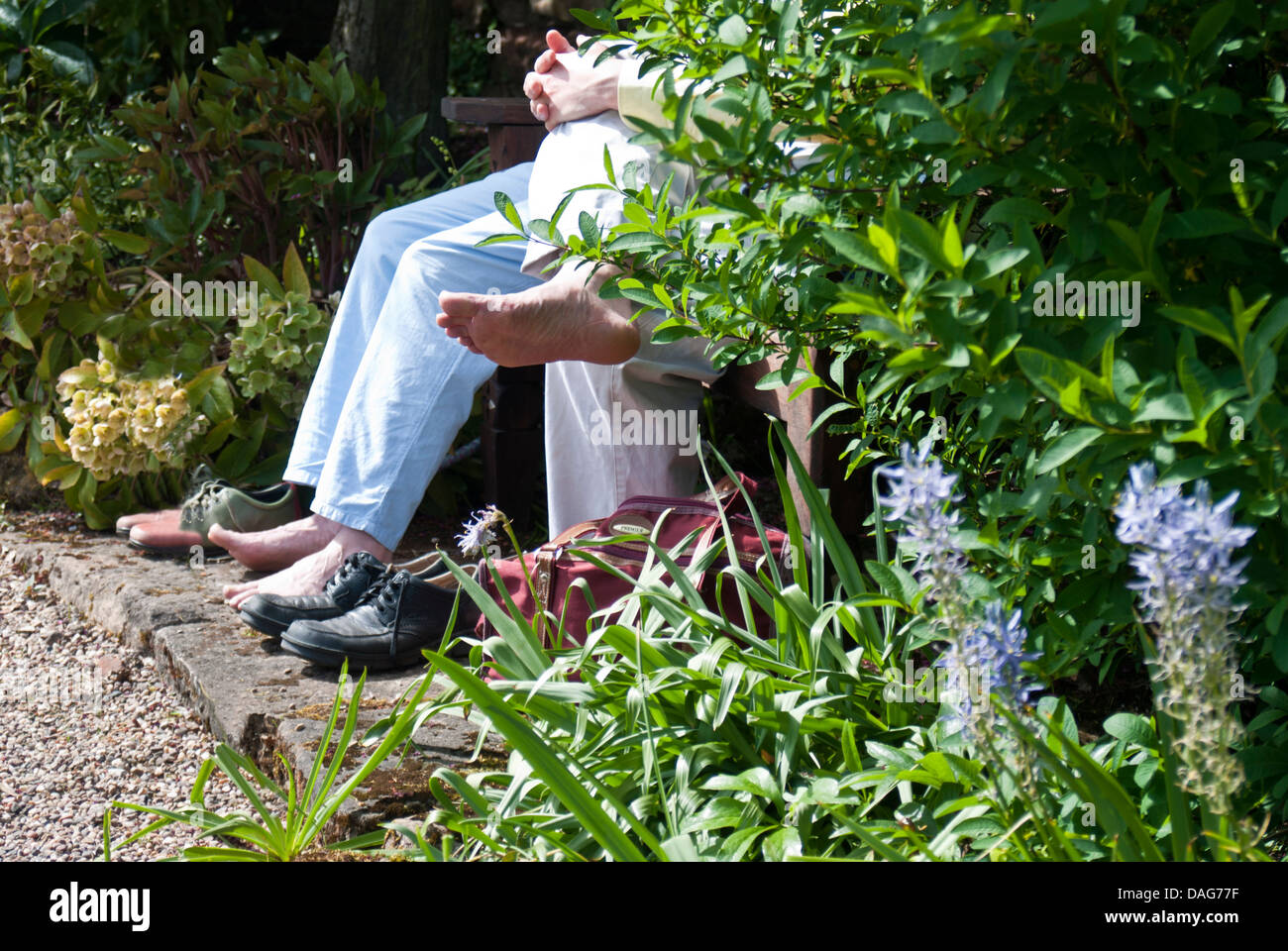 A couple sit and rest their tired feet Stock Photo