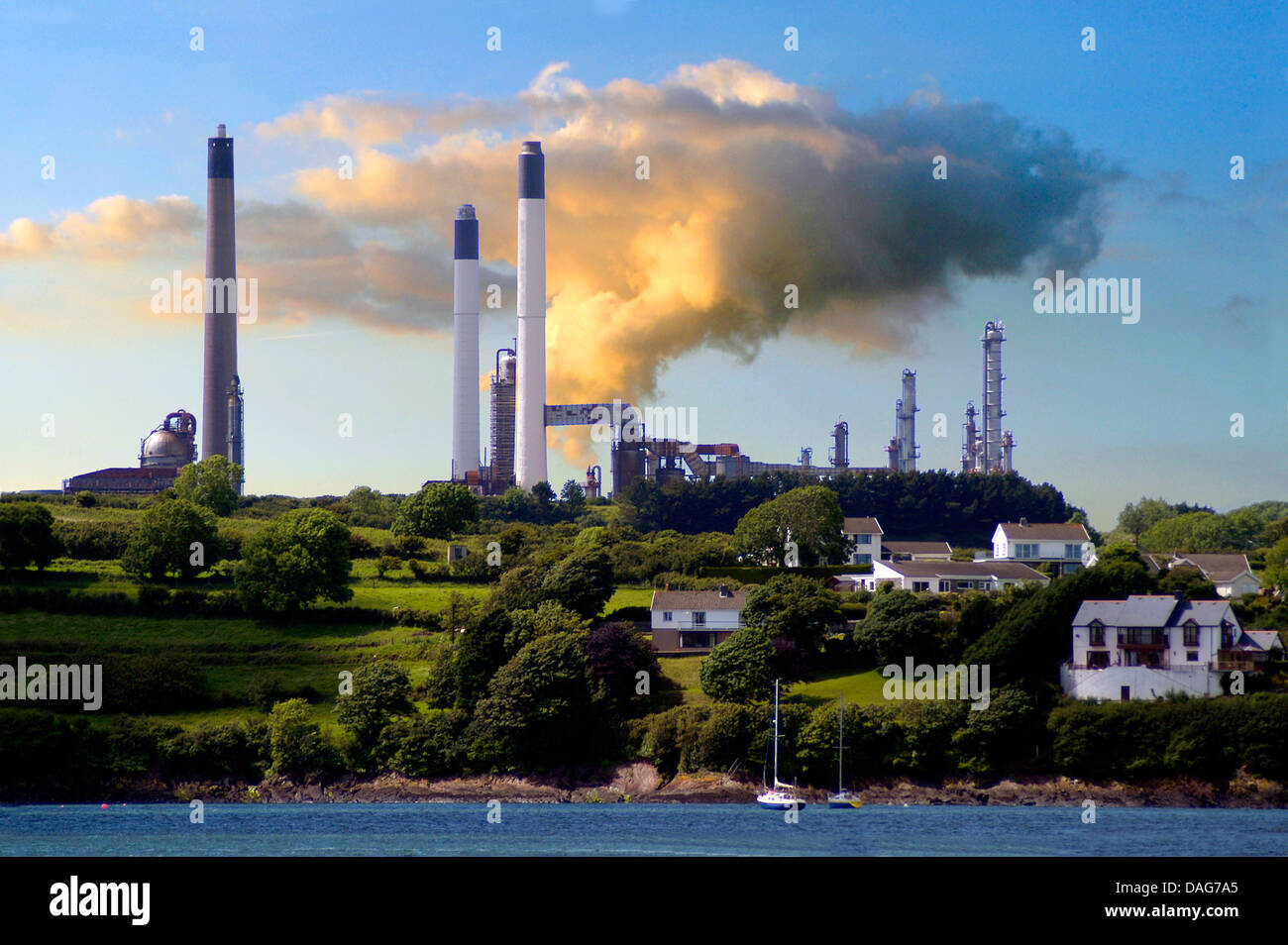lng terminal and oil raffinerie in evening light, United Kingdom, Wales, Waterson/Milford Haven Stock Photo