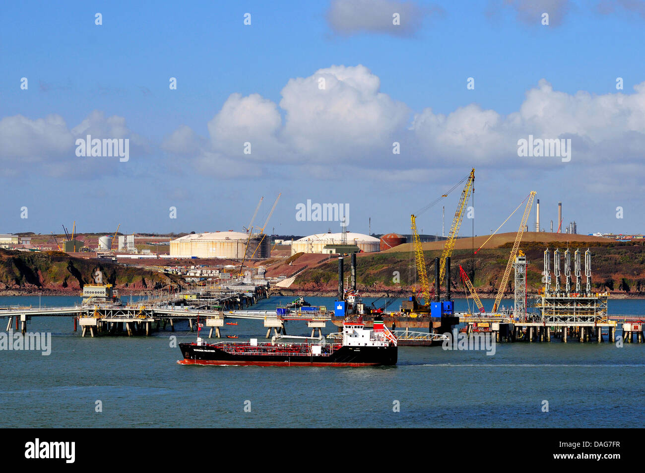 sea jetty at the harbour of a gas terminal, United Kingdom, Wales Stock Photo