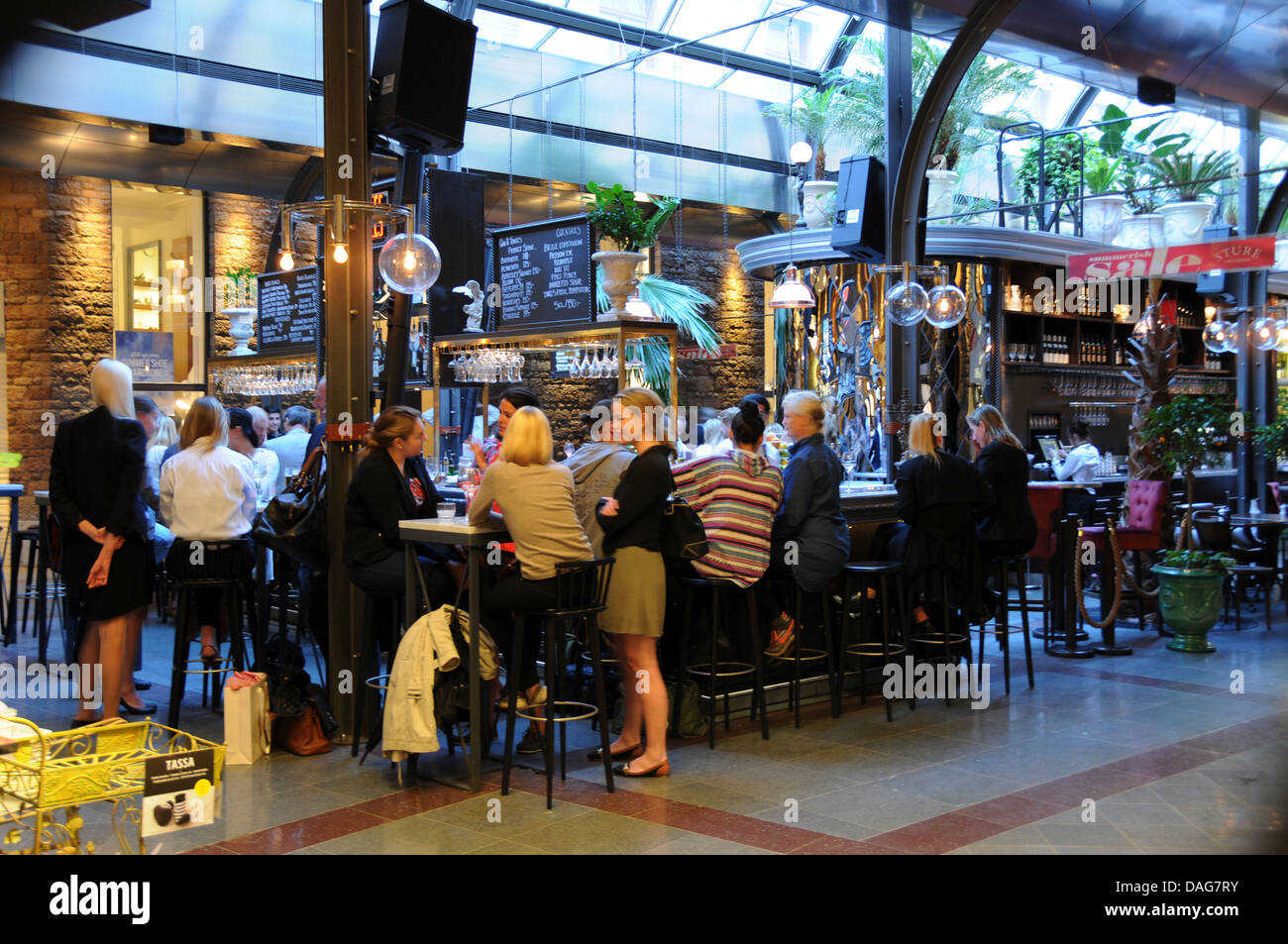 People at indoor bar and restaurants in Sture Gallerian at Stureplan in central Stockholm - Stock Image