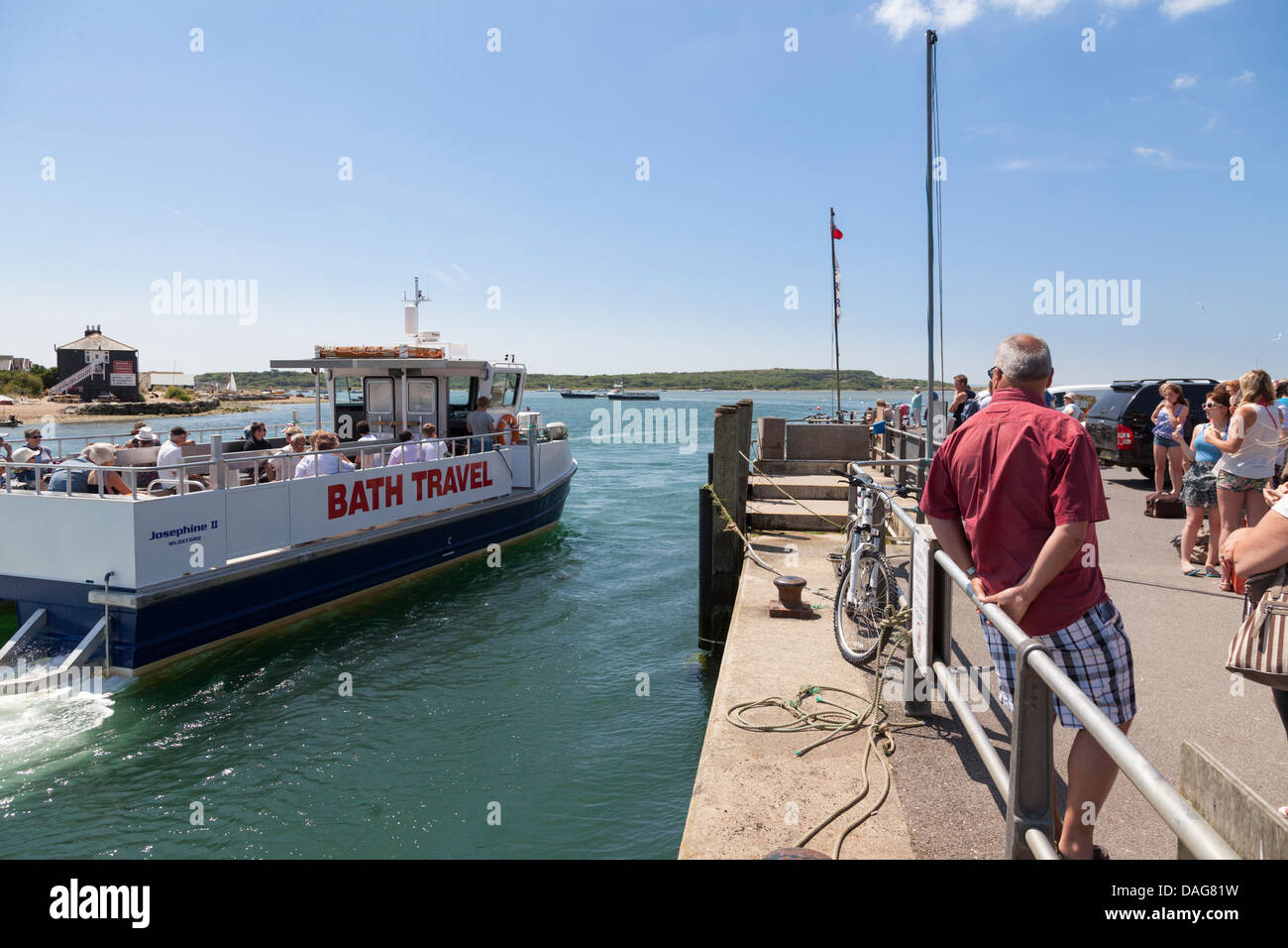 Mudeford to Hengistbury Head ferry arriving at the quay. - Stock Image