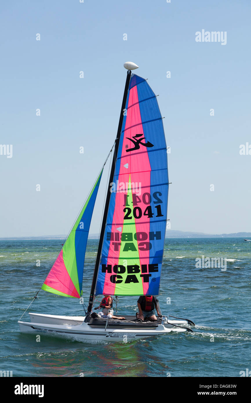 two people on Hobie Cat catamaran on sea - Stock Image