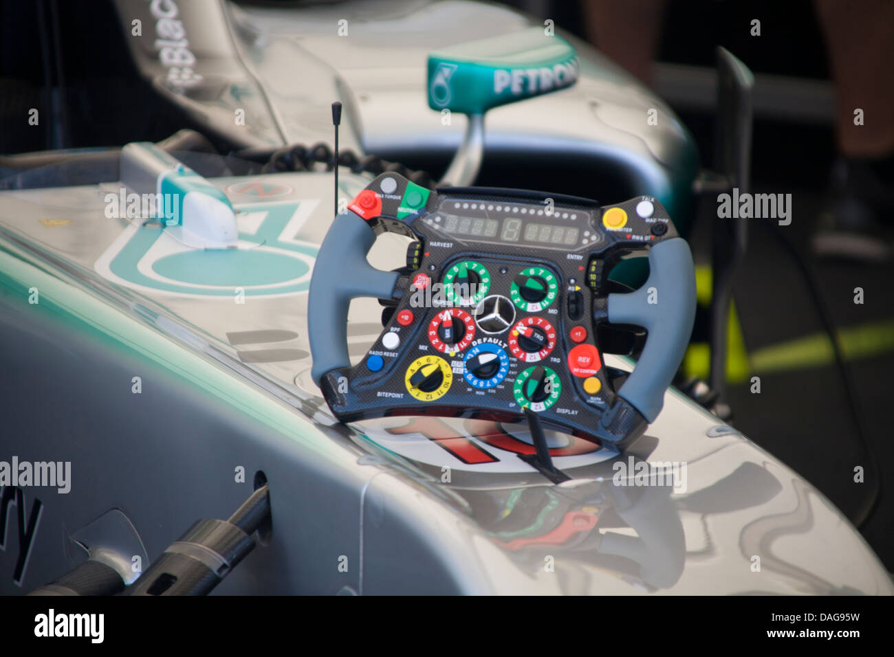 Steering wheel resting on nose of a Mercedes Formula 1 car at Goodwood Festival of Speed, Chichester, West Sussex - Stock Image