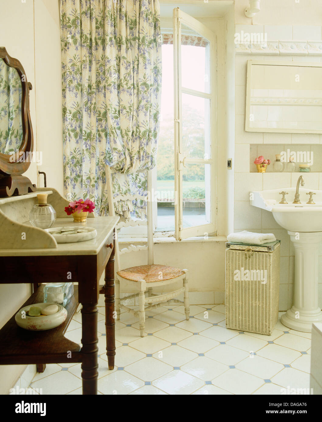 Marble Topped Washstand And White Tiled Floor In French Country Stock Photo Alamy