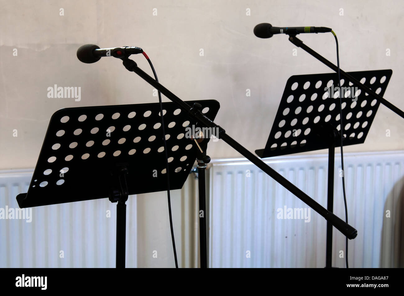 Music stands and microphones in a church - Stock Image