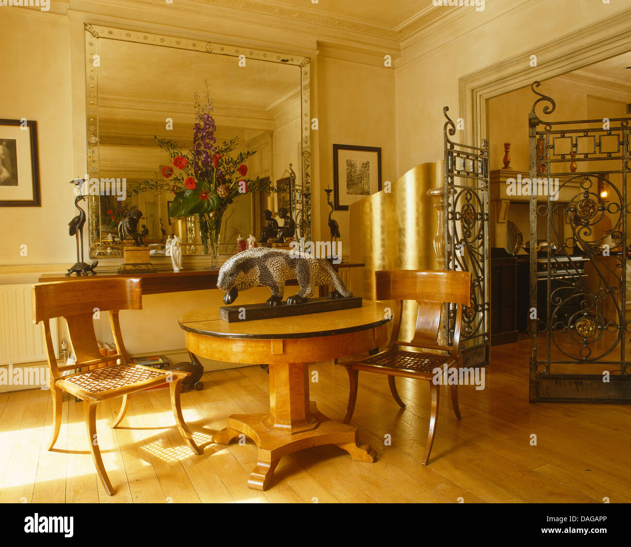 Antique Chairs And Biedermeier Table In Dining Room With