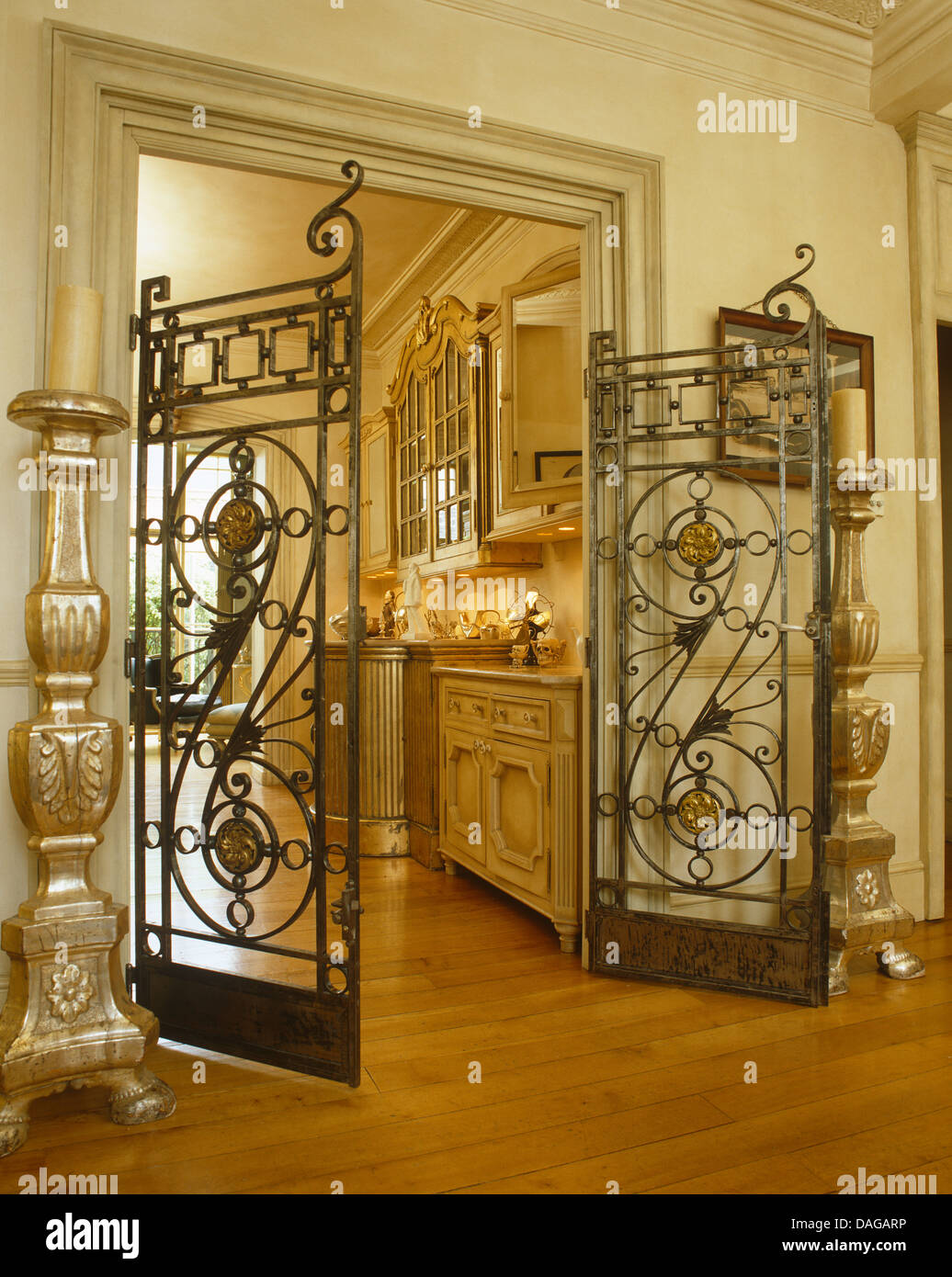 Tall Candlestick Beside Large Wrought Iron Gates On
