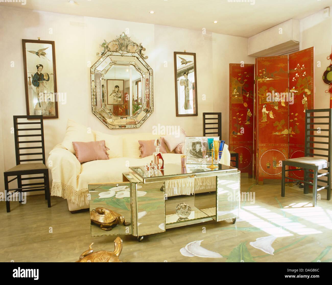 antique venetian mirror above sofa with cream throw in living room