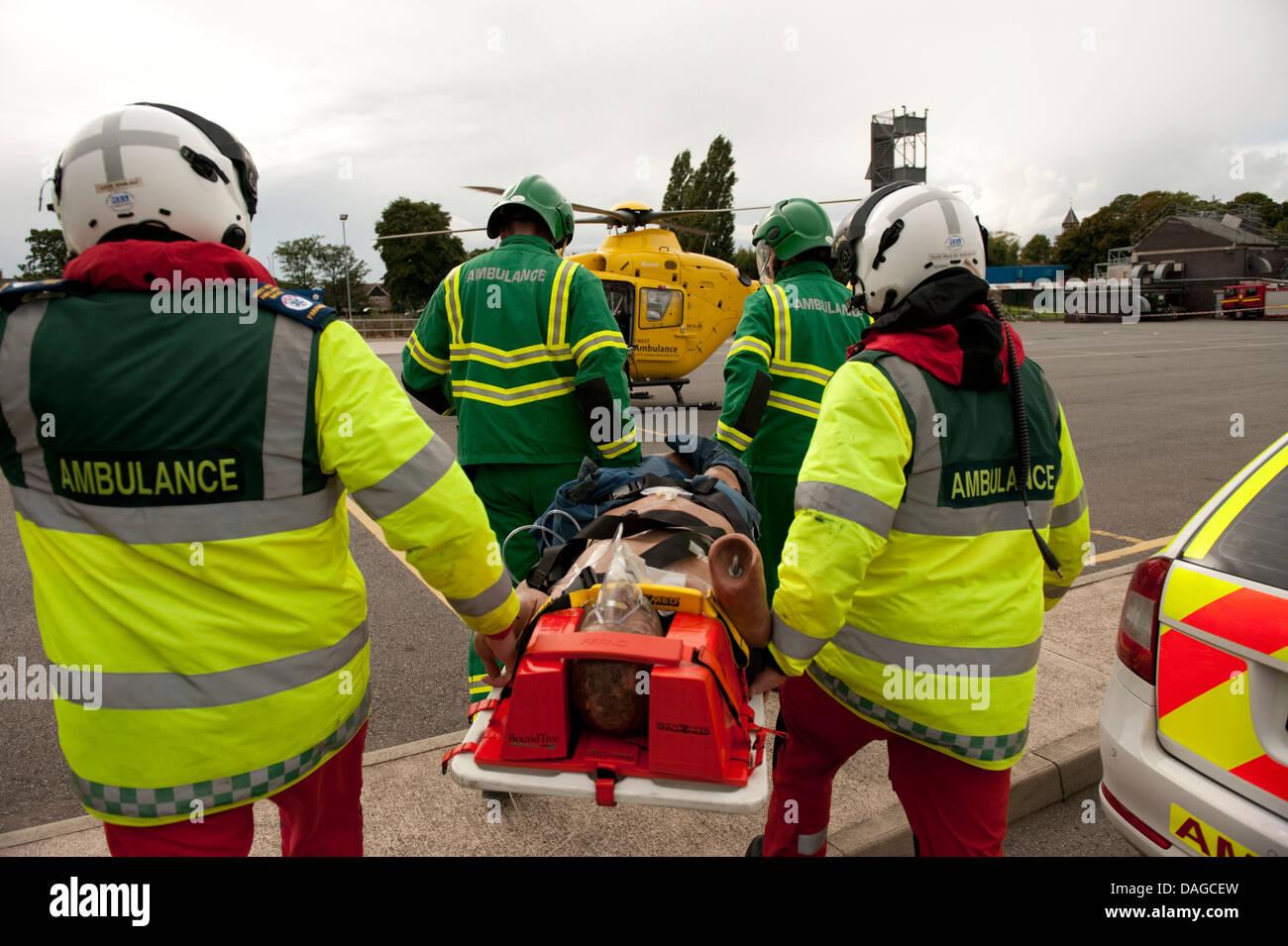 Paramedic Ambulance stretcher neck injury reconstruction - Stock Image
