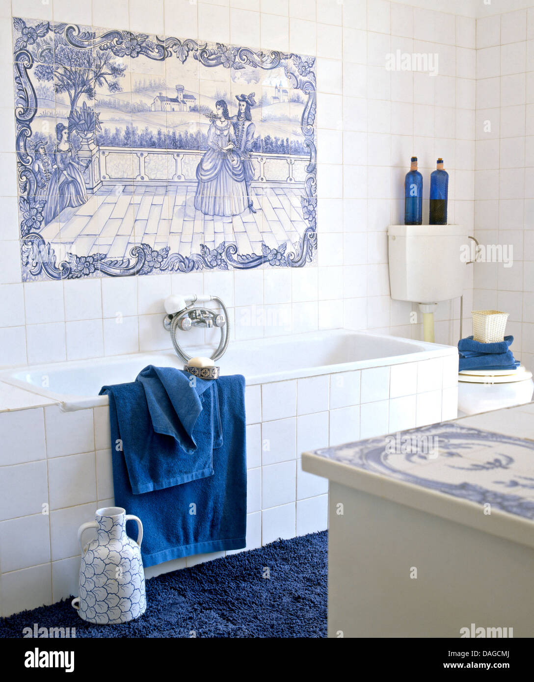 Blue+white tiled decorative panel above bath with white tiled Stock ...