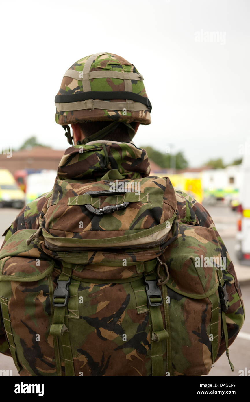 British Army Soldier backpack helmet camouflage - Stock Image