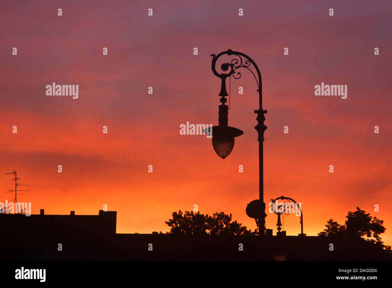 silhouette of an old street lamp at sunset, Germany, Berlin - Stock Image