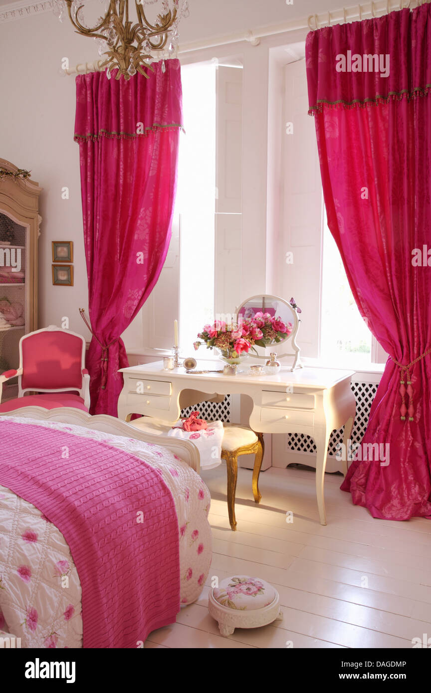 Bright Pink Curtains On Window Above White Dressing Table In Bedroom With  White Painted Floor And