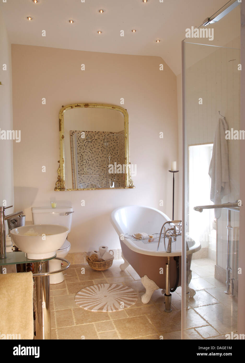 Roll Top Bath And Large Glass Shower Cabinet In Modern Bathroom With Large  Antique Mirror And Stone Tiled Floor