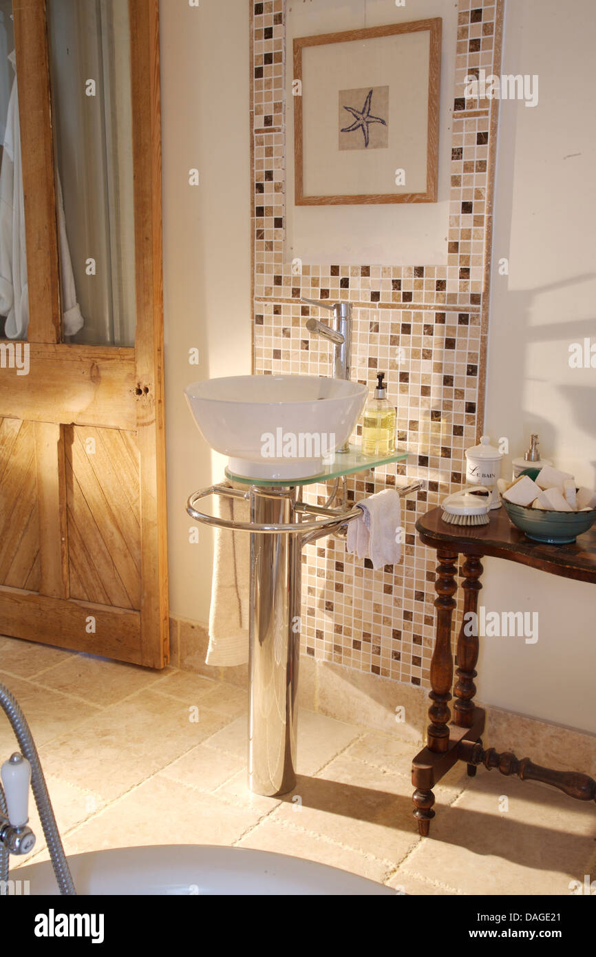 Modern Wash Basin On Chrome Pedestal In Country Bathroom With Mosaic
