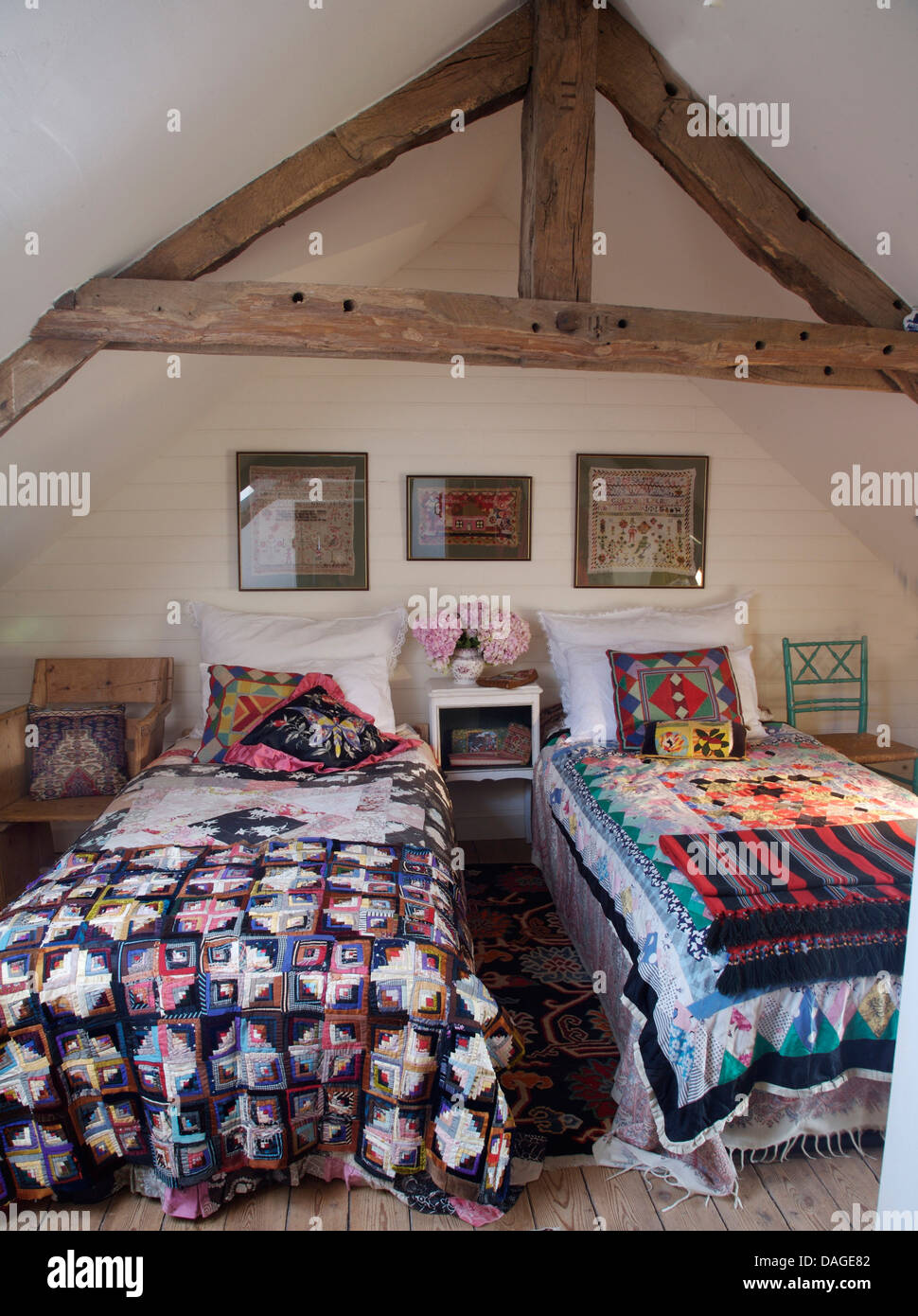Colorful Patchwork Quilts On Twin Beds In Cottage Bedroom With Rustic Stock Photo Alamy